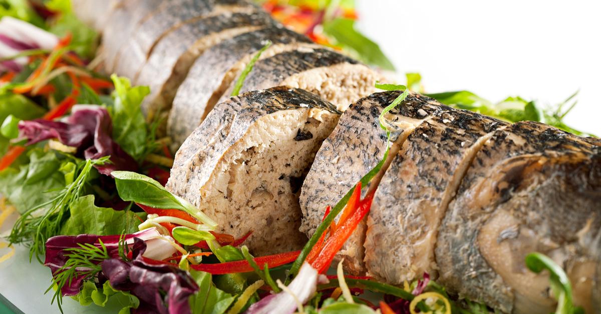 Фото Фаршированный судак, запеченный в сметане с цитрусовыми