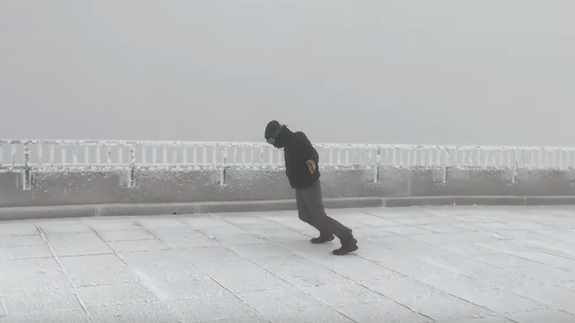 Photo of Watch a weather observer struggle to stand in 105-mph winds