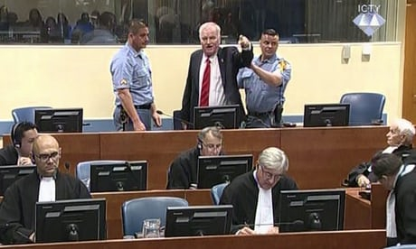 Photo of Mladić removed from court after angry outburst – video