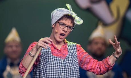 Photo of Merkel successor cleans up as Putzfrau Gretel in carnival role