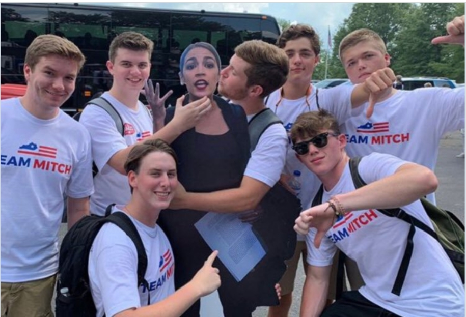 Photo of At Kentucky event, young men from 'Team Mitch' posed choking and groping an AOC cut-out