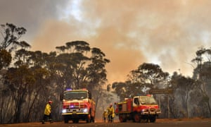 Australia fires: weather bureau says Tuesday was nation's hottest day on record – live