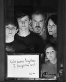 Photographer Takes Stunning Portraits Through Windows of Families Social Distancing