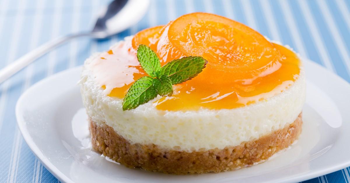 Фото Ароматный апельсиновый чизкейк непременно порадует своим совершенным вкусом и аппетитным видом.