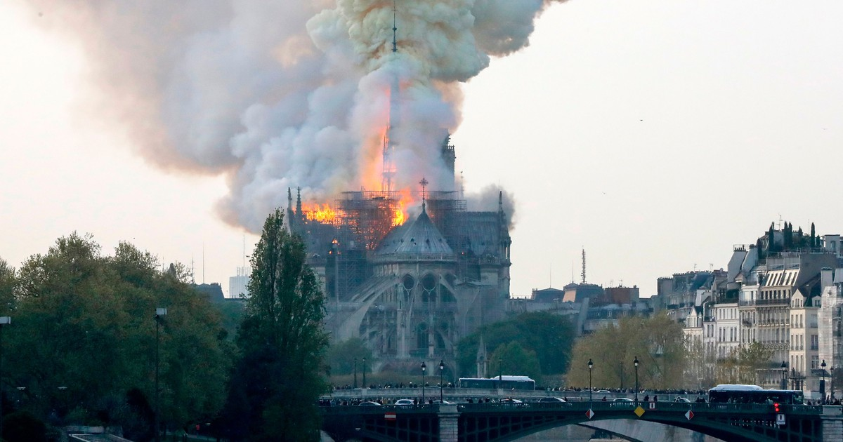 Photo of Paris searches for answers as Notre Dame smolders