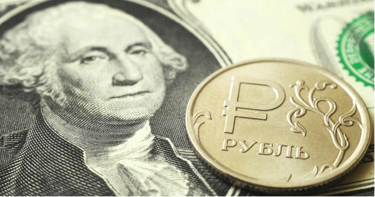 Фото Пора покупать доллары? Почему вырос рубль и что ждет его в новом году