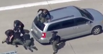 Video shows wild arrest atop a van on a Detroit interstate
