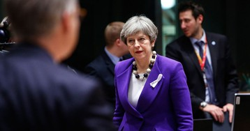 May Hints at Softer Stance on EU Migration in Brexit Trade Talks
