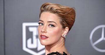 Amber Heard responde site que a acusou de cometer gafe por sair sem sutiã