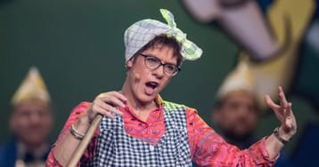 Merkel successor cleans up as Putzfrau Gretel in carnival role