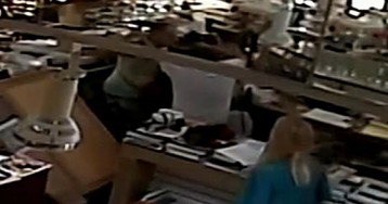 Elderly Florida jewelry store owner, wife pummel would-be robber on video