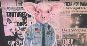 Pig-dressed-as-cop 'art' removed from building that houses police dept. Student artist allegedly wasn't after 'divisive response.'
