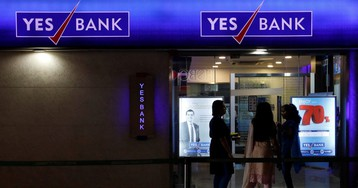 Why has YES Bank's share price halved in a month?