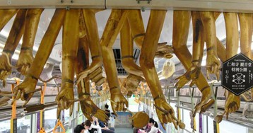 Train In Japan Decorated With Thousand-Armed Kannon Limbs Hanging From Carriage Ceiling