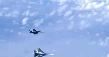 Russian fighter jet chases off NATO warplane approaching plane carrying Russian Defense Minister over neutral waters