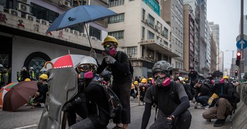 Police use water cannons and draw guns as tensions rise in Hong Kong
