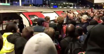 Environmental activists in London are violently clashing not with police but with commuters