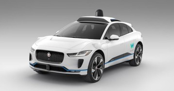 Waymo begins offering robot-taxi trips sans safety driver in Phoenix