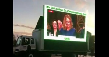 Activists play Blasey Ford testimony on big screen outside Justice Kavanaugh speech