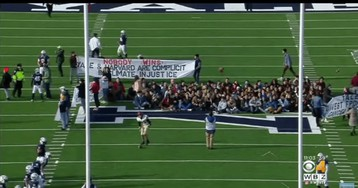'OK boomer': Hundreds of activists chant and delay Harvard-Yale football game for climate protest