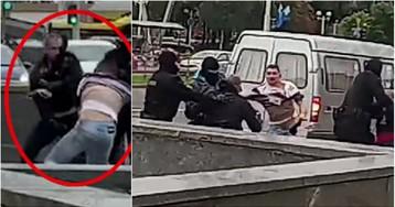 Полицейский в Минске сбежал и закрыл лицо, когда с него сняли маску (ВИДЕО)