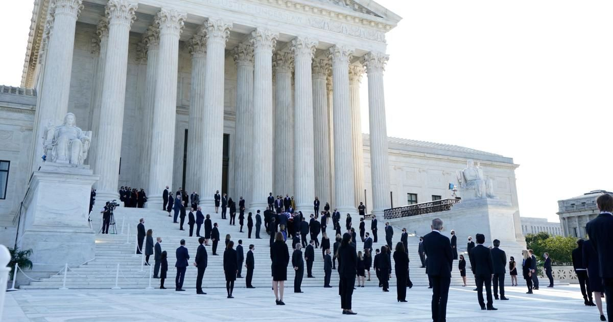 An army of RBG's clerks gathered to meet her casket