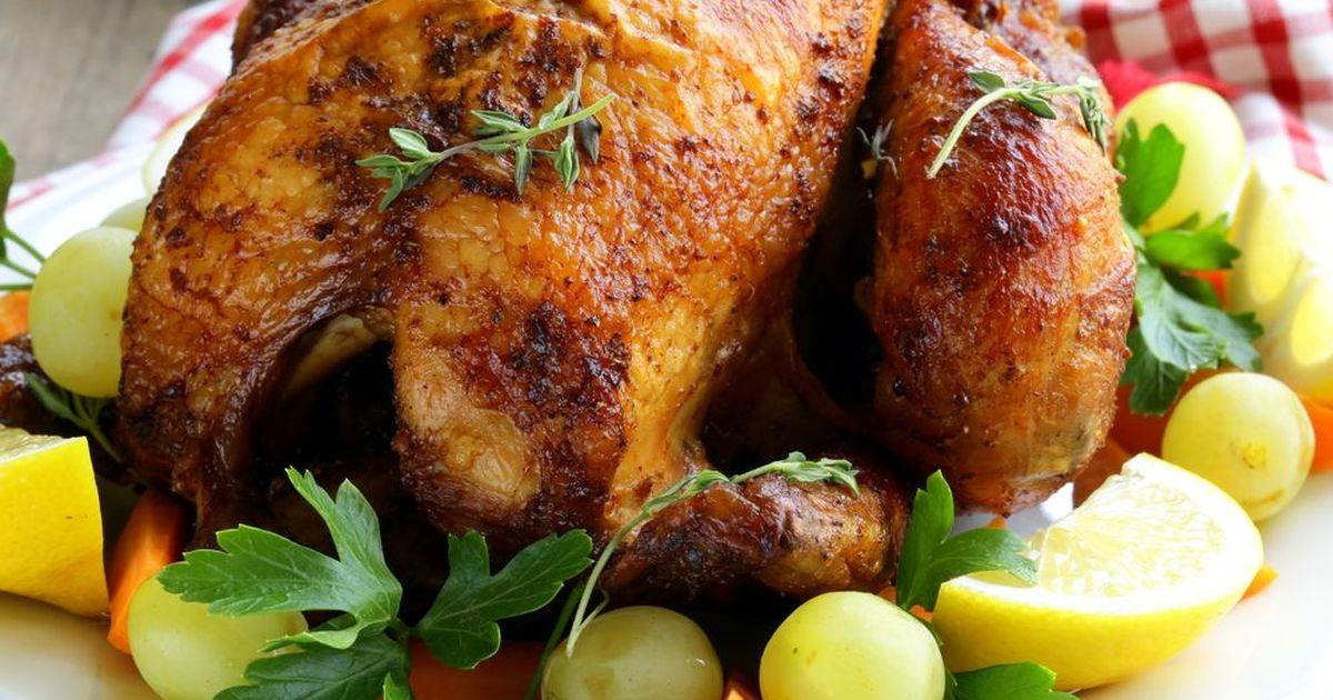 Фото Запеченная курица с пряными травами и лимоном