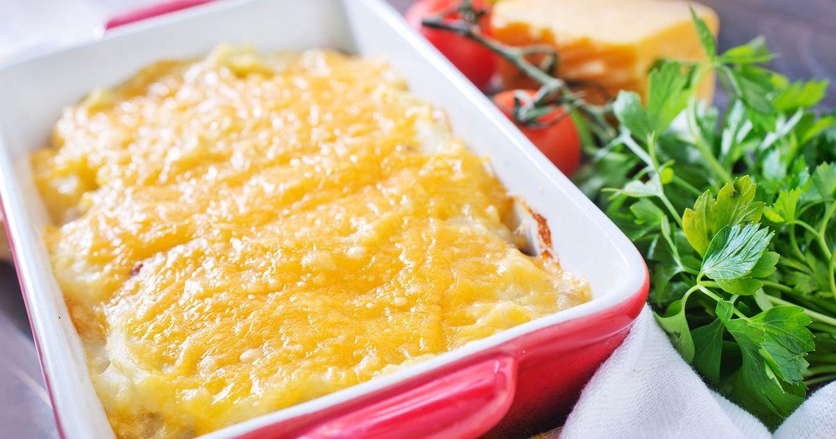 Фото Запеченная рыба с помидорами под сыром