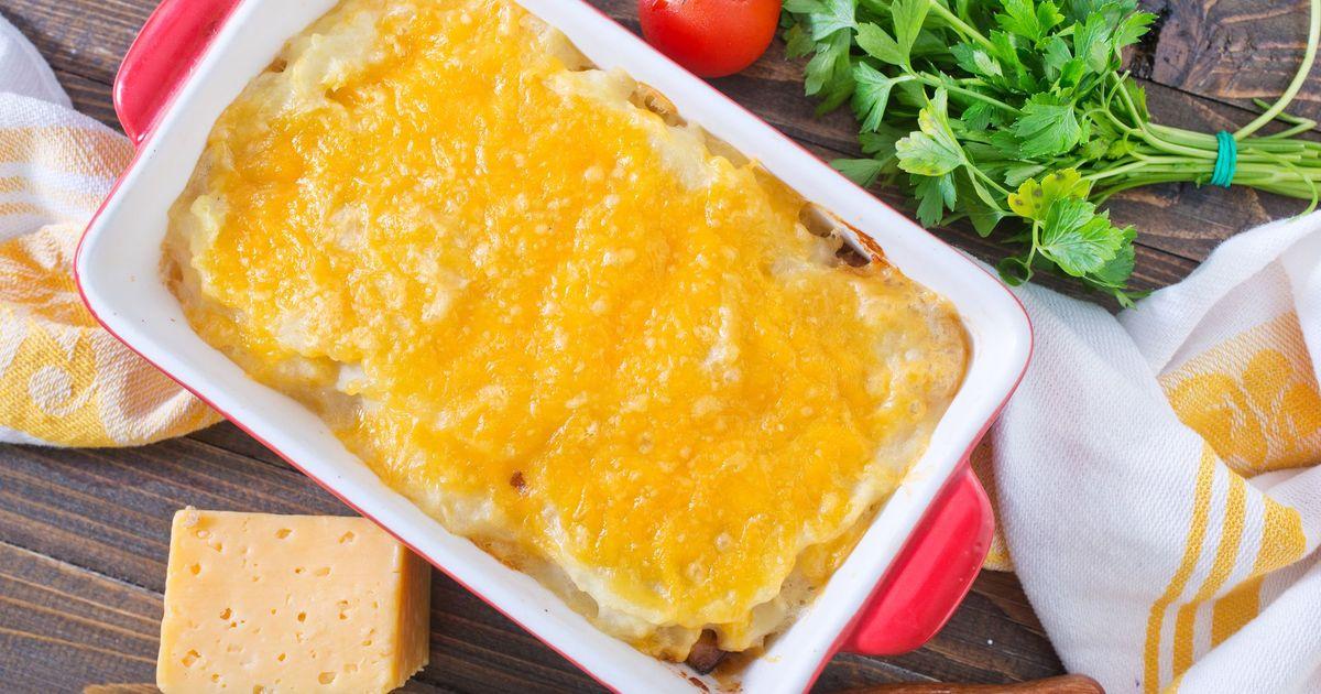 Фото Рыбная запеканка с помидорами под сыром